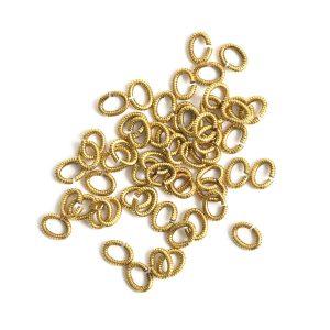 Jumpring 6mm Textured Oval<br>Antique Gold